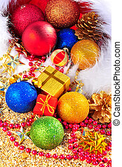 Christmas baubles and gift boxes in the christmas hat