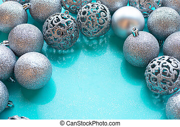 Christmas baubles decoration on blue background.
