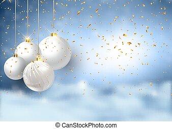 Christmas baubles on a defocussed snowy landscape