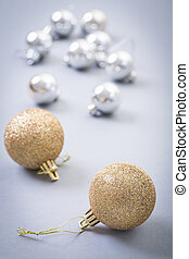 christmas baubles on gray background