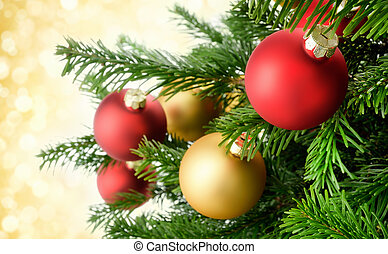 Christmas baubles on lush fir branches