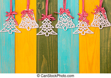 Christmas baubles over colored wooden background