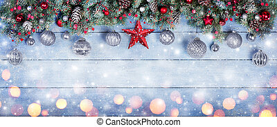Christmas Baubles With Star In Fir Branches On Snowy Wooden Plank Christmas Baubles With Star In Fir Branches On Snowy Wooden Plank