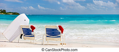 Christmas beach vacation - Panorama of two sunloungers with...