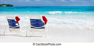 Christmas beach vacation - Two beach chairs with Santa hats...