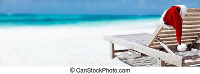 Christmas beach vacation - Panorama of sun chair with Santa...
