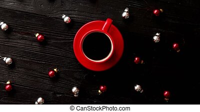 Christmas beads around hot drink - From above shot of tiny...