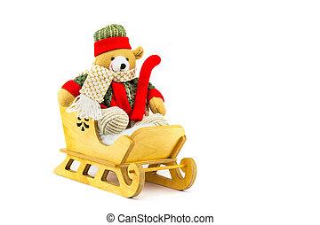 Christmas bear in wooden sleigh on white