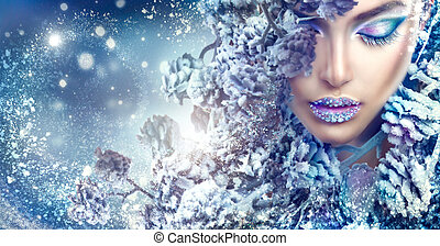 Christmas beauty girl. Winter holiday makeup with gems on lips