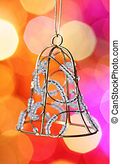 Christmas bell against blurred background