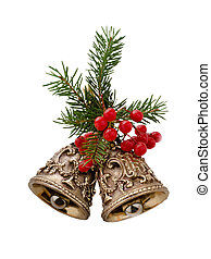 Christmas bells decorated with fir branches and berries