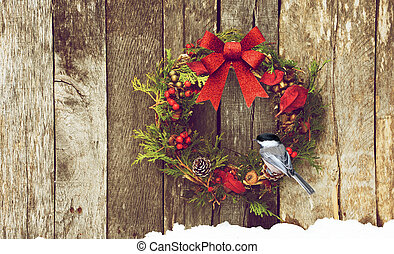 Christmas bird. - Christmas wreath with natural decorations,...