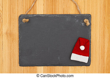 Christmas blank hanging chalkboard sign with a Santa hat on wood