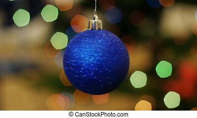 Christmas blue ball rotates at background bokeh