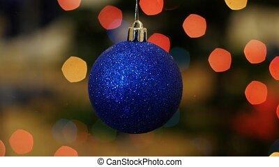 Christmas blue ball shakes at background bokeh