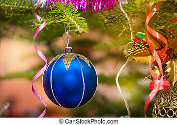 Christmas blue baubles on a tree