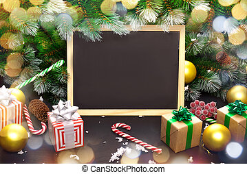Christmas Board, gift box, Christmas tree branch, Christmas decorations on wooden dark background. Top view with copy space for your text.