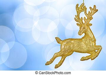 Christmas bokeh background with golden reindeer