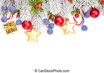 Christmas border with green Xmas tree twig and New Year decoration isolated on white background