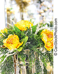 Christmas bouquet of yellow roses in a metal vase