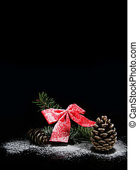 christmas bow and pine cone