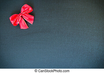 Christmas bow on a black canvas background