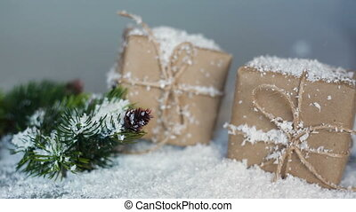 Christmas boxes for gifts and branches in the snow on a white background