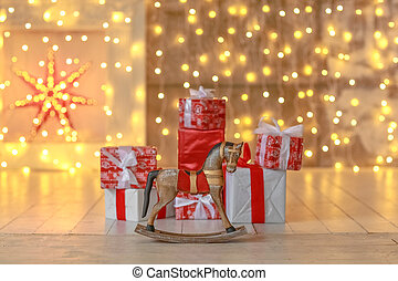 Christmas boxes on the background of garlands with blurred focus