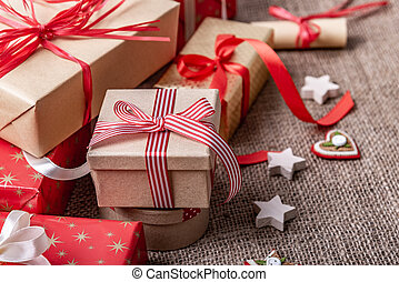 Christmas boxes with gifts on burlap background.