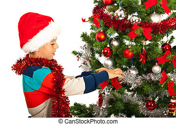 Christmas boy decorate tree - Christmas happy boy decore ...