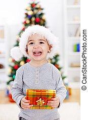 Christmas boy with present