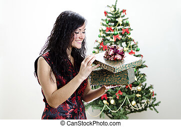 Christmas: brunette girl with gift