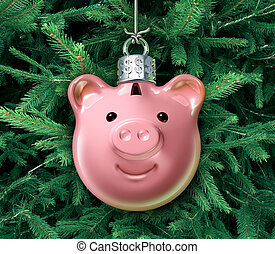 Christmas business concept with a holiday tree ornament decoration shaped as a piggy bank over a green evergreen as a financial symbol of managing gift spending money during the winter festive season.