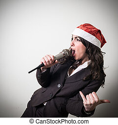 christmas businesswoman singing with microphone