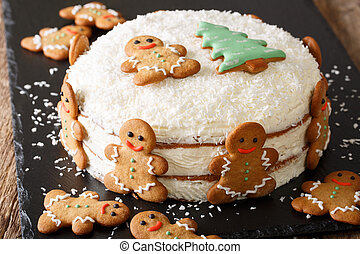 Christmas cake is decorated with gingerbread men close-up....