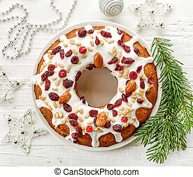 Christmas cake on white wooden table