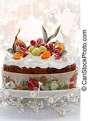 Traditional Christmas fruit cake with white frosting and sugared fruits