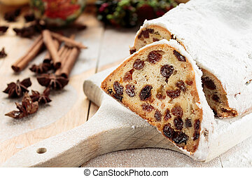 Christmas Cake, traditional German Stollen with marzipan, berries and nuts