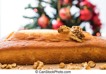 christmas cake with nuts and ornaments