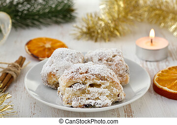 Christmas cake with powdered sugar on the plate