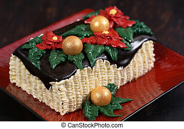 Christmas cake with red poinsettia flowers