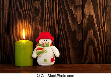 Christmas candle and snowman toy