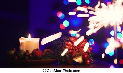 Christmas Candle and Sparks of Bengal Light on Christmas Tree. Diff. 4k