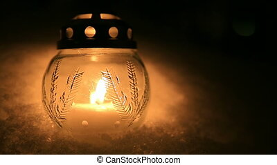 Christmas candle light in snow