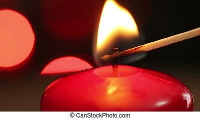 Christmas candle lit match. macro