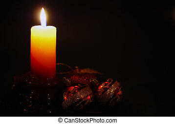 Christmas candle shining in dark