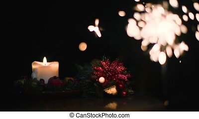 Christmas candle with Bengal fire on a black background in super slow motion