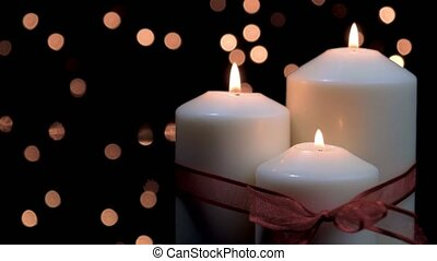 Christmas candles burning in atmospheric light - Christmas ...