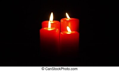 christmas candles flickering - four red christmas candles...