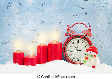 Christmas candles, snowman toy and alarm clock
